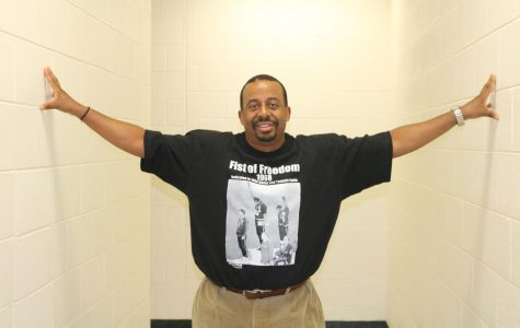 History teacher Erik Wilson wears a graphic tee featuring sprinters Tommy Smith and John Carlos accepting their medals during the 1968 Olympics in Mexico City.  Their raised fists symbolized Black Power during the height of the Civil Rights Movement.